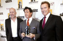Actor Sylvester Stallone (C) holds his Hollywood Career Achievement Award as he poses with California Governor Arnold Schwarzenegger (R) and actor Bruce Willis backstage at the 14th Annual Hollywood Awards Gala in Beverly Hills, California October 25, 2010. REUTERS/Mario Anzuoni (UNITED STATES - Tags: ENTERTAINMENT)