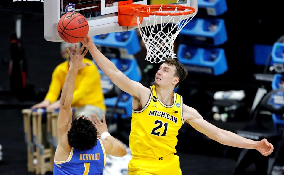 Michigan Wolverines guard Franz Wagner (21) blocks a shot by UCLA Bruins guard Jules Bernard (1) during the Elite Eight round of the 2021 NCAA Tournament on Tuesday, March 30, 2021, at Lucas Oil Stadium in Indianapolis, Ind. Mandatory Credit: Michelle Pemberton/IndyStar via USA TODAY Sports ORIG FILE ID:  20210330_jla_usa_094.jpg
