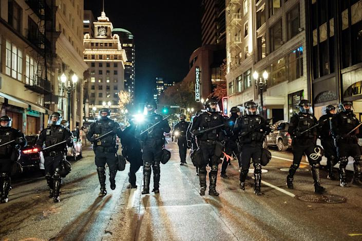 Police officers prepare to disperse protesters in Portland, Ore., on Nov. 4, 2020. (Mason Trinca/The New York Times)