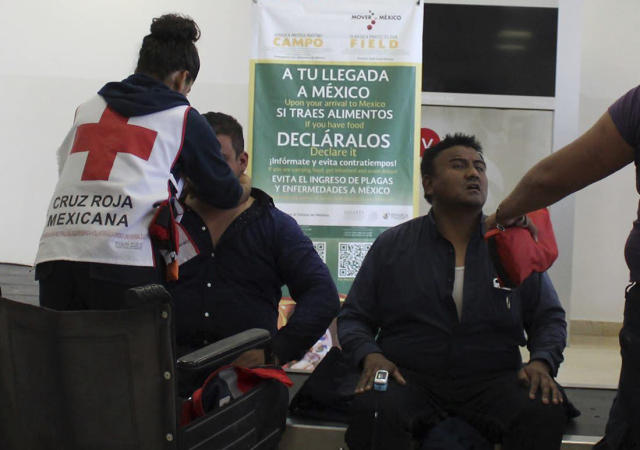 <p>In this photo released by Red Cross Durango communications office, Red Cross workers attend airline passengers who survived a plane crash, at the airport baggage area in Durango, Mexico, Tuesday, July 31, 2018. (Photo: Red Cross Durango via AP) </p>