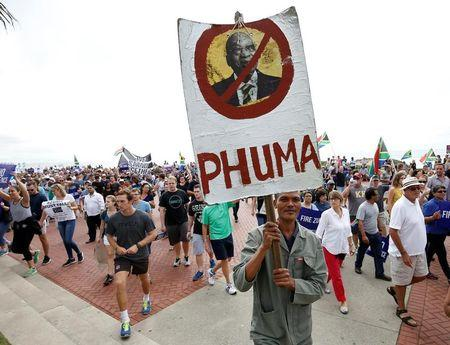 Demonstrators take part in a protest calling for the removal of South Africa's President Jacob Zuma in Durban