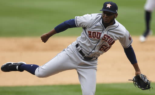 Houston Astros relief pitcher Enoli Paredes works against the Colorado Rockies in the eighth inning of a baseball game Thursday, Aug. 20, 2020, in Denver. (AP Photo/David Zalubowski)