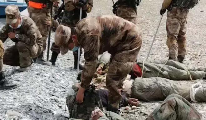 A photo circulated on a Chinese military website on Sunday purportedly shows People's Liberation Army troops standing over prone Indian soldiers following a gang fight at the Pangong Lake border with India. Photo: Handout