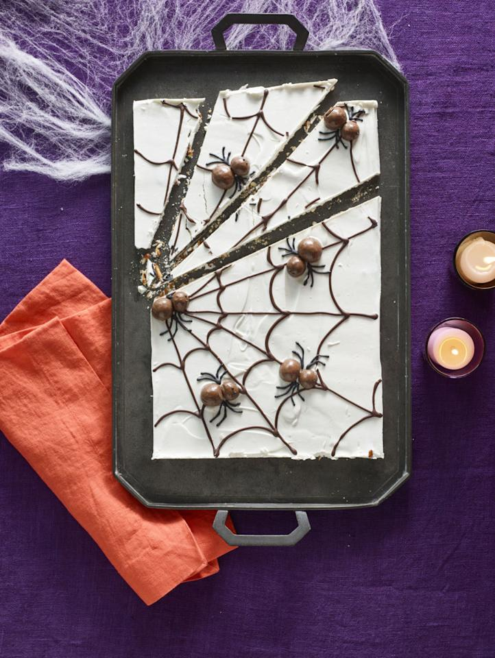 "<p>No matter how afraid of spiders guests may be, no one will be able to resist the itsy bitsy malt-ball creatures topping this delicious white chocolate-covered pretzel web.</p><p><strong><a rel=""nofollow"" href=""http://www.womansday.com/food-recipes/food-drinks/recipes/a60166/candy-cobwebs-recipe/"">Get the recipe</a>.</strong></p>"