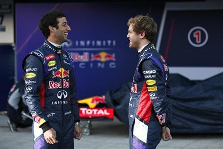Red Bull Formula One drivers Vettel of Germany and Ricciardo of Australia smile after unveiling the new RB10 at the Jerez racetrack in southern Spain