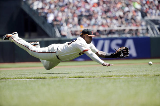 San Francisco Giants third baseman Pablo Sandoval makes a diving attempt on a bunt from Milwaukee Brewers' Carlos Gomez during the first inning of a baseball game on Sunday, Aug. 31, 2014, in San Francisco. Gomez got an infield single on the play. (AP Photo/Marcio Jose Sanchez)