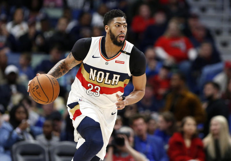 FILE - In this March 16, 2019, file photo, New Orleans Pelicans forward Anthony Davis brings the ball up during the first half of the team's NBA basketball game against the Phoenix Suns in New Orleans. Two people familiar with the situation say the Pelicans have agreed to trade Davis to the Los Angeles Lakers for point guard Lonzo Ball, forward Brandon Ingram, shooting guard Josh Hart and three first-round draft choices. The people spoke to The Associated Press on condition of anonymity because the trade cannot become official until the new league year begins July 6. ESPN first reported the trade.(AP Photo/Tyler Kaufman, File)