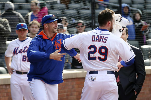 New York Mets first baseman Ike Davis (29) takes shaving cream to the face by starting pitcher Jonathon Niese after Davis hit a walk-off grand slam in the ninth inning of a baseball game against the Cincinnati Reds at Citi Field, Saturday, April 5, 2014, in New York. The Mets won 6-3. (AP Photo/John Minchillo)