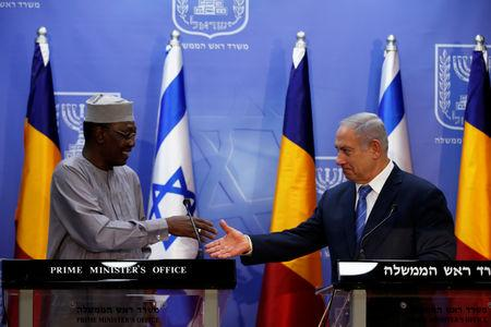 Israeli Prime Minister Benjamin Netanyahu (R) prepares to shake hands with Chadian President Idriss Deby as they deliver joint statements in Jerusalem November 25, 2018. REUTERS/Ronen Zvulun