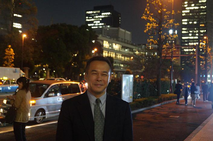 Go Ito, a professor of international relations at Meiji University, walks through Kasumigaseki, Tokyo, at night. (Photo: Michael Walsh/Yahoo News)