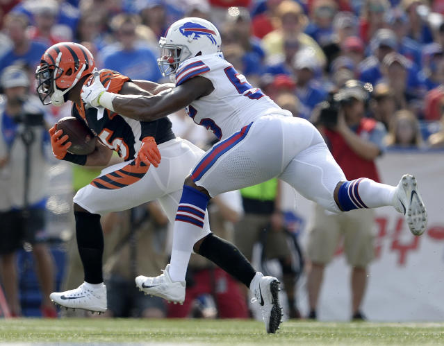 FILE - In this Aug. 26, 2018, file photo, Cincinnati Bengals running back Giovani Bernard, left, is tackled by Buffalo Bills defensive end Jerry Hughes during the first half of a preseason NFL football game in Orchard Park, N.Y. The Bengals travel to Orchard Park this week for the Bills' home-opener. (AP Photo/Adrian Kraus, File)