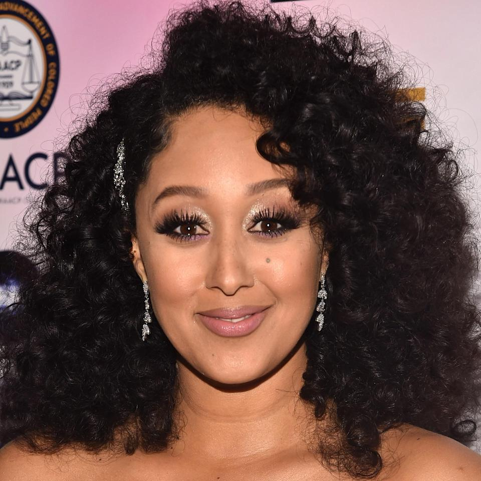 """Sometimes a little frizz is a good thing. It works for Tamera Mowry-Housley along with the slight side part that helps to separate curls, creating a fuller and more polished look. """"This works because she has very copious defined curls,"""" says Riley. """"It's a cut that can be easily maintained and forgiving in-between cuts. It's also easy for her to style manually – she can finger coil and go."""" This haircut typically works best on type 3 hair because it has a super defined curl and a natural buoyancy that will allow it to achieve the layered look."""