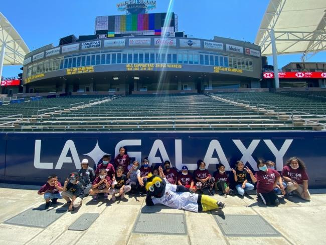 Youth participants enrolled in the Hope Street summer program spend the afternoon enjoying a specially designed LA Galaxy Youth Soccer Clinic, working directly with club coaching staff and LA Galaxy mascot Cozmo at Dignity Health Sports Park on June 25, 2021.