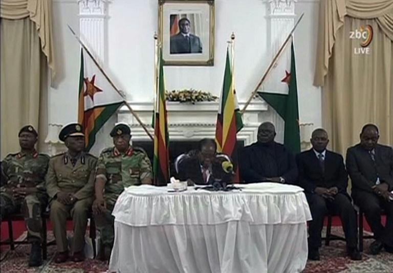 In his speech, telecast by the Zimbabwe Broadcasting corporation (ZBC), Mugabe defied expectations he would quit and said he would preside over an upcoming party congress. He was flanked by the generals who are behind the country's military takeover