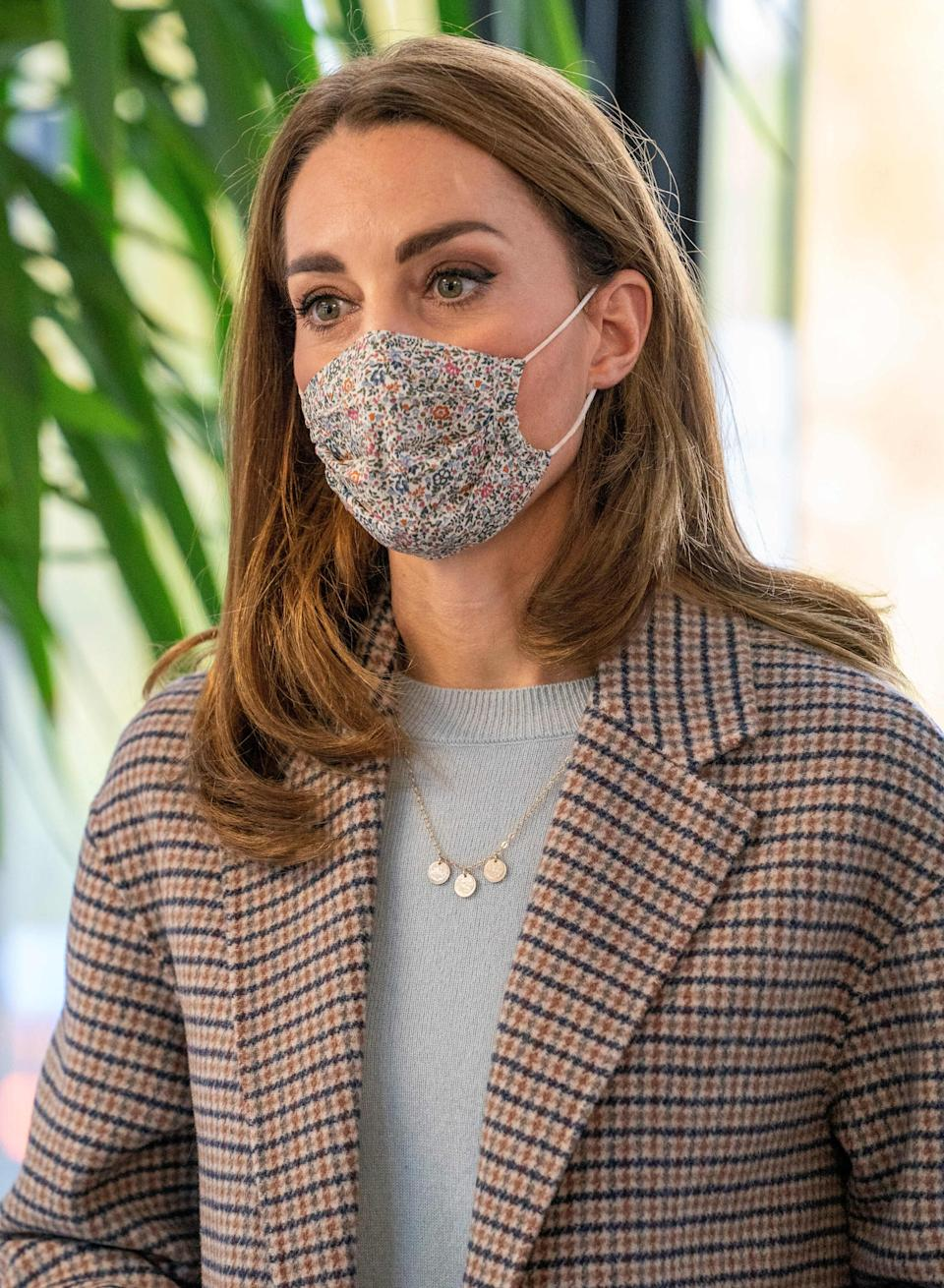 The Duchess of Cambridge wore a checked wool coat from Massimo Dutti for her visit to the University of Derby on 6 October.  (Getty Images)