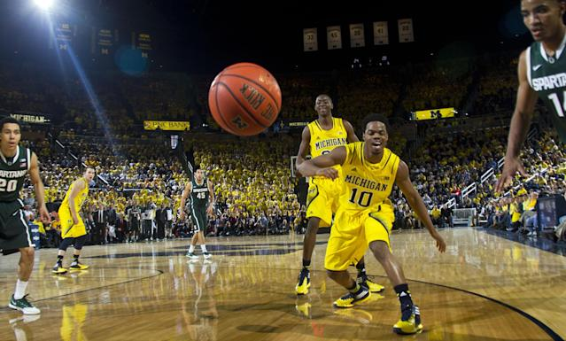 Michigan guard Derrick Walton Jr. (10) watches the ball bounce out of bounce off his hands, in the first half of an NCAA college basketball game against Michigan State at Crisler Center in Ann Arbor, Mich., Sunday, Feb. 23, 2014. (AP Photo/Tony Ding)