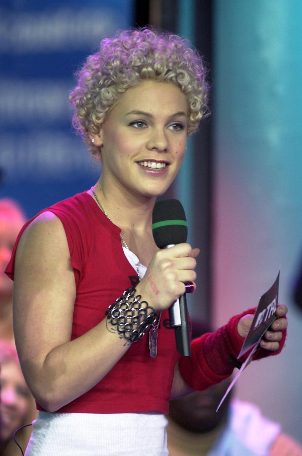 <p>Pink sported a curly 'do on <b>TRL</b> in 2001.</p>