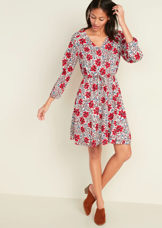 From ankle booties and a motorcycle jacket to a cozy knit and sneakers, there's nothing this dress can't be paired with. (Photo: Old Navy)