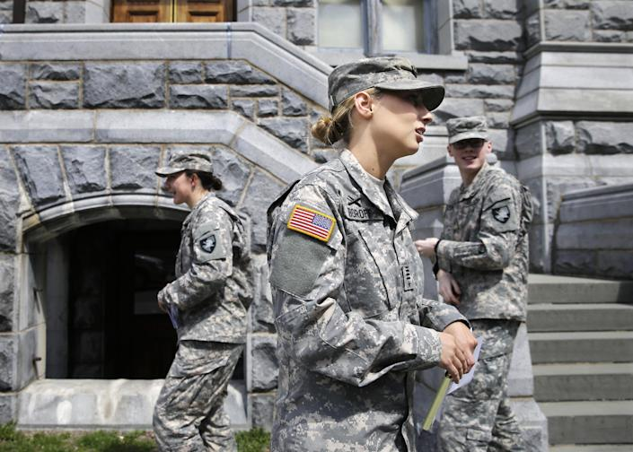 In this April 9, 2014 photo, West Point cadet Austen Boroff, center, of Chatham, N.J., gathers with others as she waits to march to lunch at the United States Military Academy in West Point, N.Y. With the Pentagon lifting restrictions for women in combat jobs, Lt. Gen. Robert Caslen Jr. has set a goal of boosting the number of women above 20 percent for the new class reporting this summer. (AP Photo/Mel Evans)
