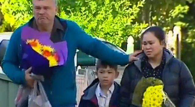 The family of the two-year-old boy, Jamie Robertson, Pitchanan and eight-year-old son Jonathon, returned to the scene to lay flowers. Photo: 7 News