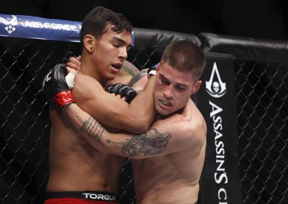 Jeremy Larsen (R) fights against Andre Fili in their catchweight bout during UFC 166. (USA TODAY Sports)