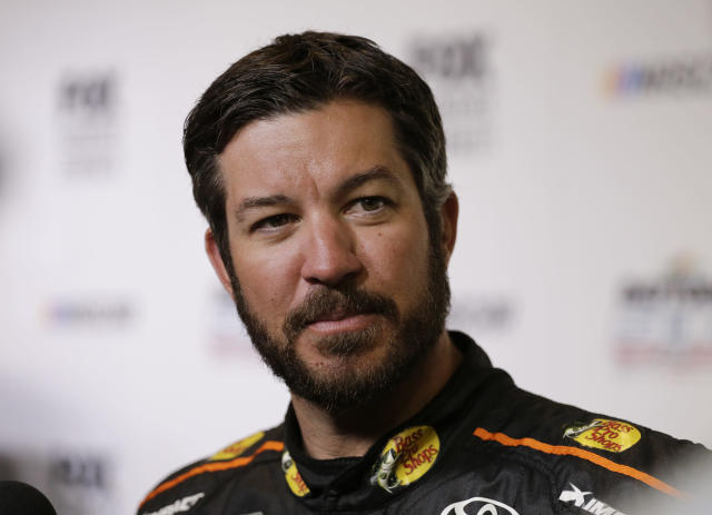 "<a class=""link rapid-noclick-resp"" href=""/nascar/sprint/drivers/380/"" data-ylk=""slk:Martin Truex Jr"">Martin Truex Jr</a>. during media day for the NASCAR Daytona 500 auto race at Daytona International Speedway, Wednesday, Feb. 14, 2018, in Daytona Beach, Fla. (AP Photo/Terry Renna)"