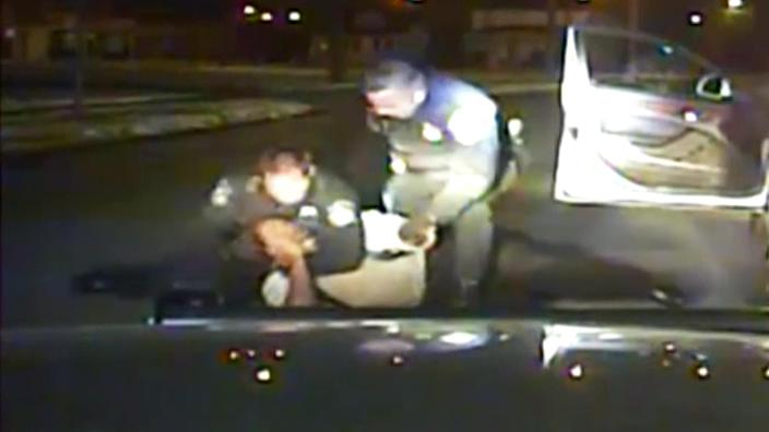 Dash cam from the Inkster, Mich., police shows the arrest of Floyd Dent, who was pulled from his car and repeatedly punched in the head. (Inkster Police Department)
