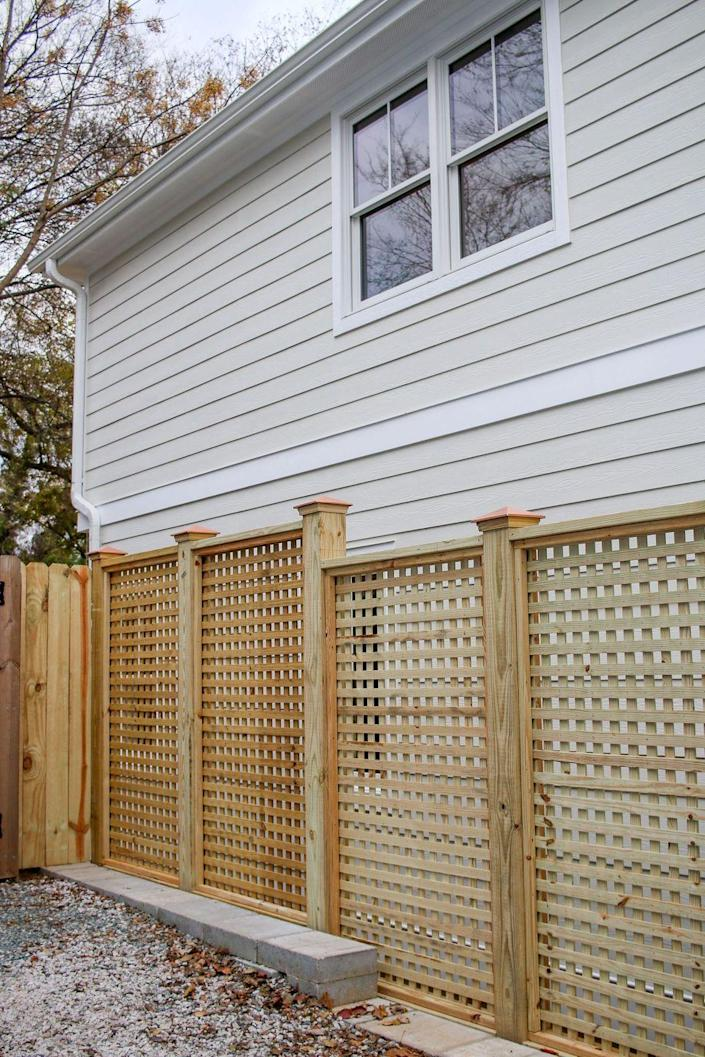 "<p>Pre-fab sheets of square lattice are attached to pressure-treated posts to create this gorgeous fence. The design affords privacy without a feeling of being hemmed in. Create an entire row, or erect a few strategically-placed panels. <br></p><p><strong>Get the tutorial at <a href=""https://www.prettyhandygirl.com/how-to-build-window-pane-lattice-privacy-fence-and-gate/"" rel=""nofollow noopener"" target=""_blank"" data-ylk=""slk:Pretty Handy Girl"" class=""link rapid-noclick-resp"">Pretty Handy Girl</a>. </strong></p><p><a class=""link rapid-noclick-resp"" href=""https://go.redirectingat.com?id=74968X1596630&url=https%3A%2F%2Fwww.homedepot.com%2Fp%2FAcurio-Latticeworks-Square-32-in-x-4-ft-White-Vinyl-Decorative-Screen-Panel-3248PVCW-SQR%2F203154129&sref=https%3A%2F%2Fwww.thepioneerwoman.com%2Fhome-lifestyle%2Fgardening%2Fg32651791%2Fdecorative-garden-fence-ideas%2F"" rel=""nofollow noopener"" target=""_blank"" data-ylk=""slk:SHOP DECORATIVE LATTICE PANELS"">SHOP DECORATIVE LATTICE PANELS</a></p>"