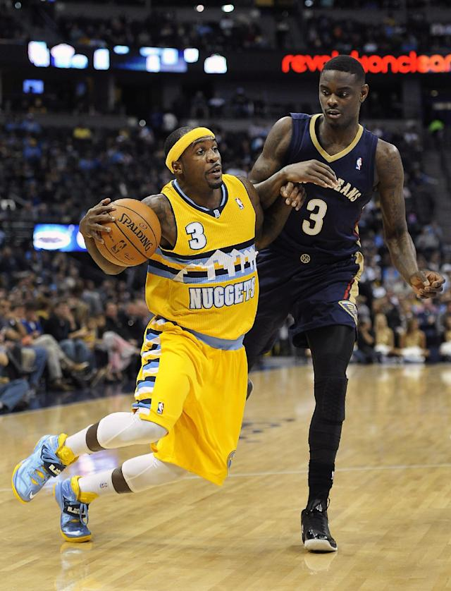 Denver Nuggets guard Ty Lawson, left, is fouled by New Orleans Pelicans guard Anthony Morrow, right, as he drives to the basket in the first half of an NBA basketball game on Wednesday, April 2, 2014, in Denver. (AP Photo/Chris Schneider)