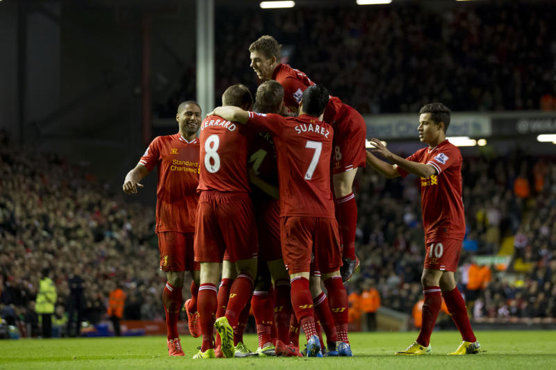 Liverpool's Daniel Sturridge is swamped by jubilant teammates including Jon Flanagan, top, after scoring against Sunderland during their English Premier League soccer match at Anfield Stadium, Liverpool, England, Wednesday March 26, 2014. (AP Photo/Jon Super)