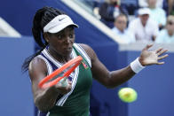 Sloane Stephens, of the United States, returns a shot to Angelique Kerber, of Germany, during the third round of the US Open tennis championships, Friday, Sept. 3, 2021, in New York. (AP Photo/Elise Amendola)