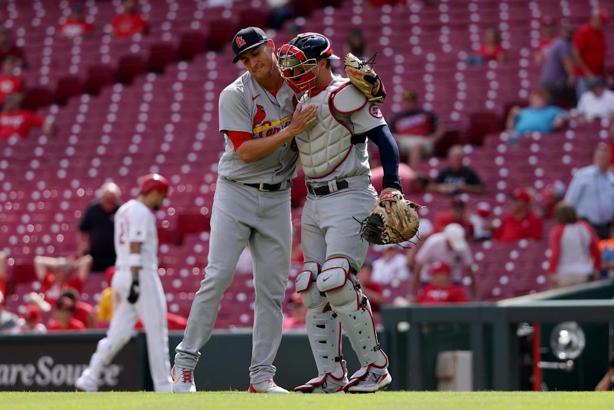 CINCINNATI, OHIO - SEPTEMBER 01: Giovanny Gallegos #65 and Andrew Knizner #7 of the St. Louis Cardinals celebrate after beating the Cincinnati Reds 5-4 during game one of a doubleheader at Great American Ball Park on September 01, 2021 in Cincinnati, Ohio. (Photo by Dylan Buell/Getty Images)