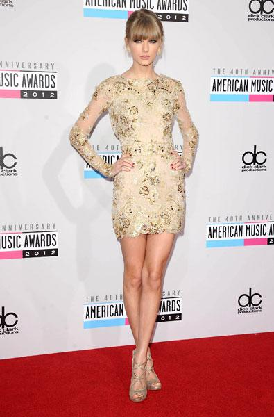 "<b>Taylor Swift</b><br><br>Taylor Swift was <a target=""_blank"" href=""http://uk.lifestyle.yahoo.com/american-music-awards-2012--taylor-swift--hayden-panettiere-and-ginnifer-goodwin-dazzle-in-nude-gowns.html"">voted the best dressed</a> at the American Music Awards in LA this week in a Zuhair Murad embellished mini dress. She finished the look with a pair of metallic strappy stilettos and smokey eye make-up.<br><br><b>[Related: <a target=""_blank"" href=""http://uk.lifestyle.yahoo.com/photos/american-music-awards-2012-best-and-worst-dressed-list-slideshow/"">Taylor Swift is best dressed at American Music Awards</a>]</b><br>"