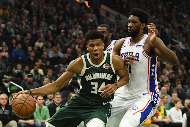 Giannis Antetokounmpo #34 of the Milwaukee Bucks is defended by Joel Embiid #21 of the Philadelphia 76ers . (Photo by Stacy Revere/Getty Images)