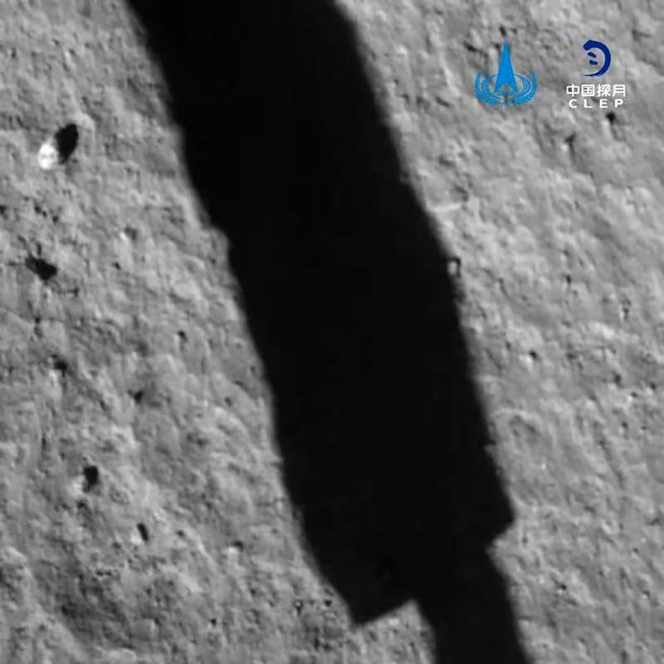 In this image taken by camera aboard Chang'e 5 spacecraft provided by China National Space Administration, its shadow is reflected on the surface of the moon during its landing process on Tuesday, Dec. 1, 2020. The Chinese spacecraft landed on the moon Tuesday to bring back lunar rocks to Earth for the first time since the 1970s, the government announced. (China National Space Administration via AP)