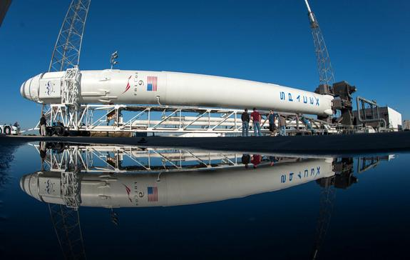 SpaceX's Falcon 9 rocket and Dragon capsule roll out from the hangar for the CRS-2 launch to the International Space Station to deliver NASA cargo in March 2013.