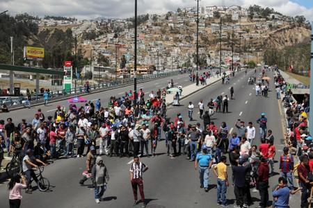 Trucks block main roads during protests after Ecuador's President Lenin Moreno's government ended four-decade-old fuel subsidies, in Carapungo, near Quito