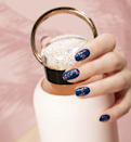 """Nail art with a low time commitment seems to be in high demand across the country, and few places do it better than NYC's <a href=""""https://www.instagram.com/p/BwM3aS5AhP7/?igshid=1s1arkk3edgw"""" rel=""""nofollow noopener"""" target=""""_blank"""" data-ylk=""""slk:Jin Soon salon"""" class=""""link rapid-noclick-resp"""">Jin Soon salon</a>. """"The confetti topping is fun, while still looking slick,"""" says founder Jin Soon Choi of this contrasting look. The how-to is simple: base coat, two coats of <a href=""""https://jinsoon.com/beau/"""" rel=""""nofollow noopener"""" target=""""_blank"""" data-ylk=""""slk:Jin Soon Beau"""" class=""""link rapid-noclick-resp"""">Jin Soon Beau</a>, and a topping of <a href=""""https://jinsoon.com/fab/"""" rel=""""nofollow noopener"""" target=""""_blank"""" data-ylk=""""slk:Fab"""" class=""""link rapid-noclick-resp"""">Fab</a> or <a href=""""https://jinsoon.com/dotty/"""" rel=""""nofollow noopener"""" target=""""_blank"""" data-ylk=""""slk:Dotty"""" class=""""link rapid-noclick-resp"""">Dotty</a> and <a href=""""https://jinsoon.com/ohko/"""" rel=""""nofollow noopener"""" target=""""_blank"""" data-ylk=""""slk:Ohko"""" class=""""link rapid-noclick-resp"""">Ohko</a>. """"Since there is no form or pattern, you can simply apply it randomly where ever you want and it's going to look great,"""" she says."""