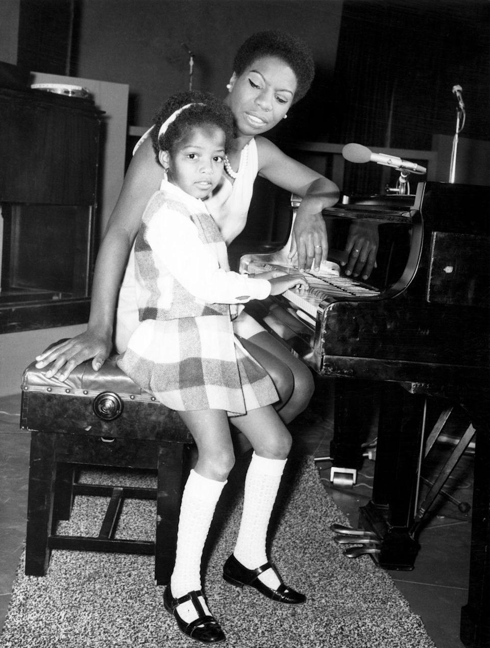<p>Nina's daughter, Lisa, accompanies her to the recording studio in England in May 1968, where she played the piano while her mother recorded <em>T</em><em>he</em> <em>Sound of Soul</em>. </p>