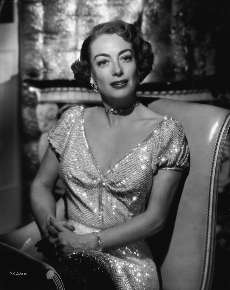Crawford poses in a sequin dress in 1935.