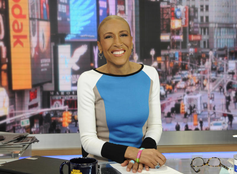 """This Jan. 24, 2013 photo released by ABC shows Robin Roberts on """"Good Morning America,"""" in New York. Roberts will be back on the job at the """"Good Morning America"""" anchor desk on Feb. 20. Her return will be five months to the day since her bone marrow transplant to treat a rare blood disorder. (AP Photo/ABC, Ida Mae Astute)"""