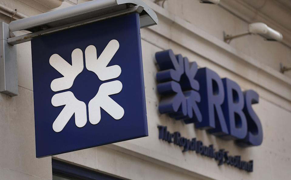 File photo dated 03/04/13 of an RBS sign. Royal Bank of Scotland has said the two top bosses of its investment banking arm, NatWest Markets, have stepped down.