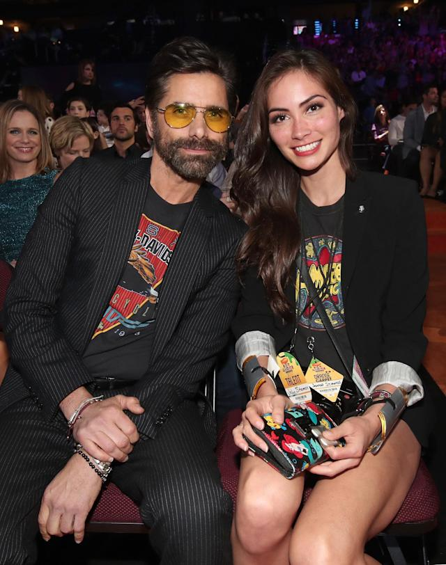 John Stamos and Caitlin McHugh at Nickelodeon's 2017 Kids' Choice Awards on March 11. (Photo: Getty Images)