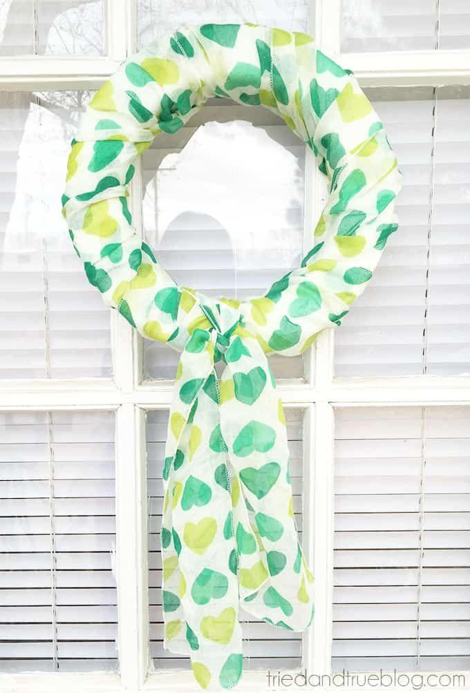 """<p>If you have a green scarf and a foam wreath core, then you have everything you need to make this nifty Paddy's Day wreath.</p><p><strong>Get the tutorial at <a href=""""https://www.triedandtrueblog.com/st-patricks-day-5-minute-scarf-wreath/"""" rel=""""nofollow noopener"""" target=""""_blank"""" data-ylk=""""slk:Tried and True"""" class=""""link rapid-noclick-resp"""">Tried and True</a>.</strong></p><p><a class=""""link rapid-noclick-resp"""" href=""""https://www.amazon.com/foam-wreath-form/s?k=foam+wreath+form&tag=syn-yahoo-20&ascsubtag=%5Bartid%7C2164.g.35012898%5Bsrc%7Cyahoo-us"""" rel=""""nofollow noopener"""" target=""""_blank"""" data-ylk=""""slk:SHOP FOAM WREATH FORMS"""">SHOP FOAM WREATH FORMS</a><br></p>"""