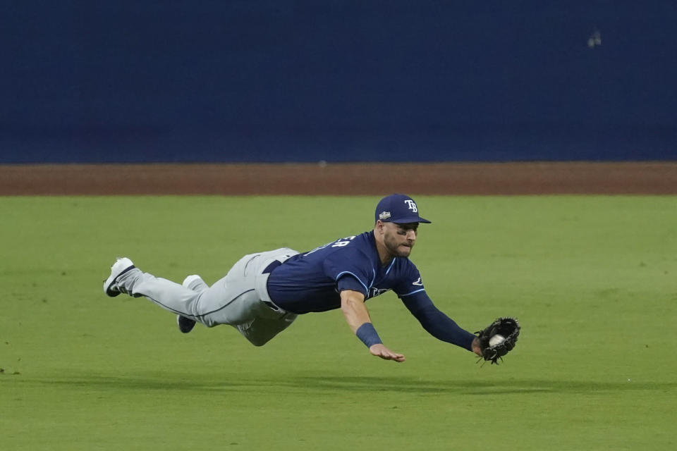Tampa Bay Rays center fielder Kevin Kiermaier makes a leaping catch on a fly ball by Houston Astros Carlos Correa during the third inning in Game 3 of a baseball American League Championship Series, Tuesday, Oct. 13, 2020, in San Diego. (AP Photo/Ashley Landis)