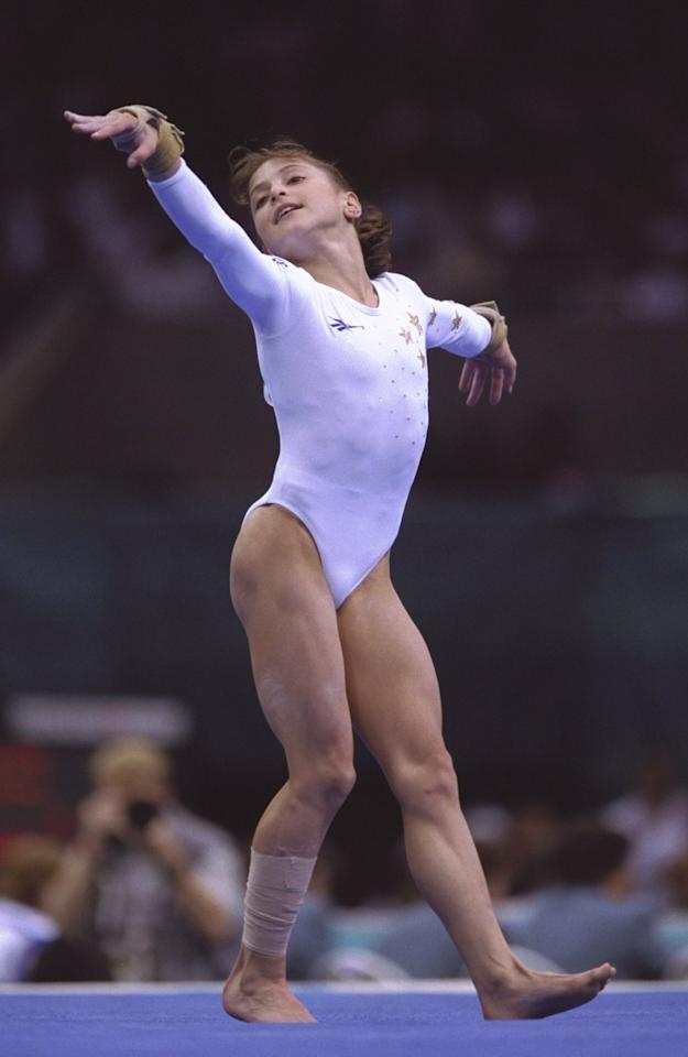 25 Jul 1996: Dominique Moceanu of the USA during the women''s individual rotation at the Georgia Dome at the 1996 Centennial Olympic Games in Atlanta, Georgia.