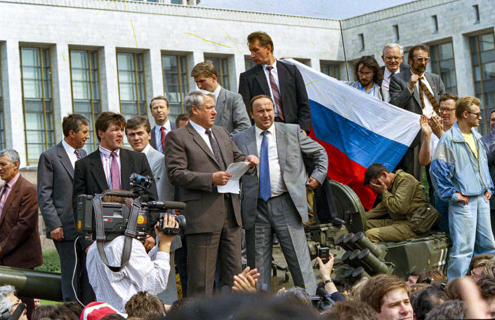 FILE - In this Monday, Aug. 19, 1991 file photo, Boris Yeltsin, president of the Russian Federation, makes a speech from atop a tank in front of the Russian parliament building in Moscow, Russia. When a group of top Communist officials ousted Soviet leader Mikhail Gorbachev 30 years ago and flooded Moscow with tanks, the world held its breath, fearing a rollback on liberal reforms and a return to the Cold War confrontation. But the August 1991 coup collapsed in just three days, precipitating the breakup of the Soviet Union that plotters said they were trying to prevent. (AP Photo, File)