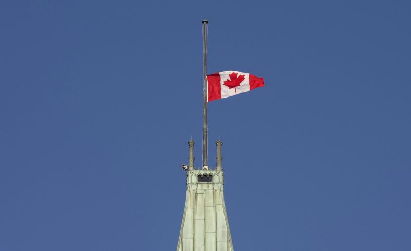 <p> The flag flies at half-mast on the Peace tower Monday Jan. 30, 2017 in Ottawa. It was announced Monday that the flag would fly at half-mast in memory of the victims of the Quebec City shooting.(Adrian Wyld/The Canadian Press via AP) </p>