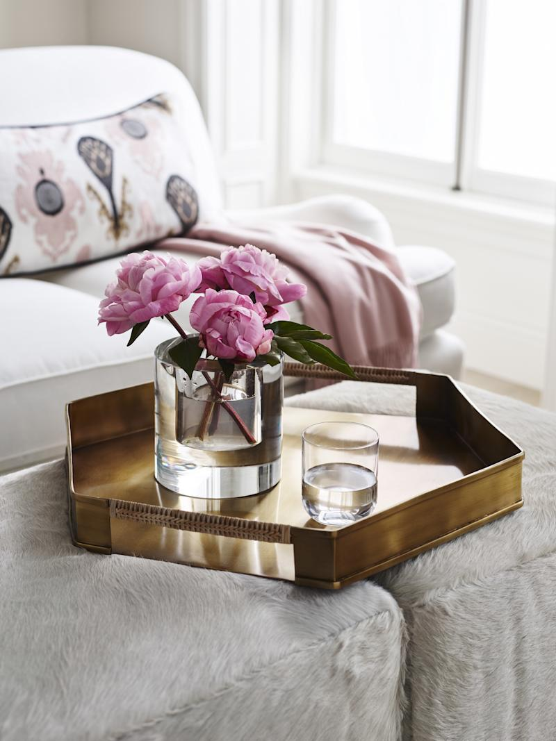 A hexagonal brass tray, which is part of the new line.