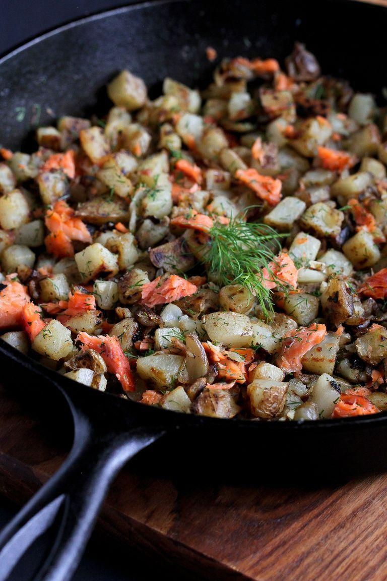 """<p>Smoked salmon lovers, this one's for you. Just break up the smoked fish and add to a skillet of sautéed potatoes and onions for a tasty and filling breakfast (or lunch, or dinner!).</p><p><strong>Get the recipe from <a href=""""https://www.thepioneerwoman.com/food-cooking/recipes/a81078/smoked-salmon-dill-breakfast-hash/"""" rel=""""nofollow noopener"""" target=""""_blank"""" data-ylk=""""slk:Dara Michalski"""" class=""""link rapid-noclick-resp"""">Dara Michalski</a>.</strong> </p>"""